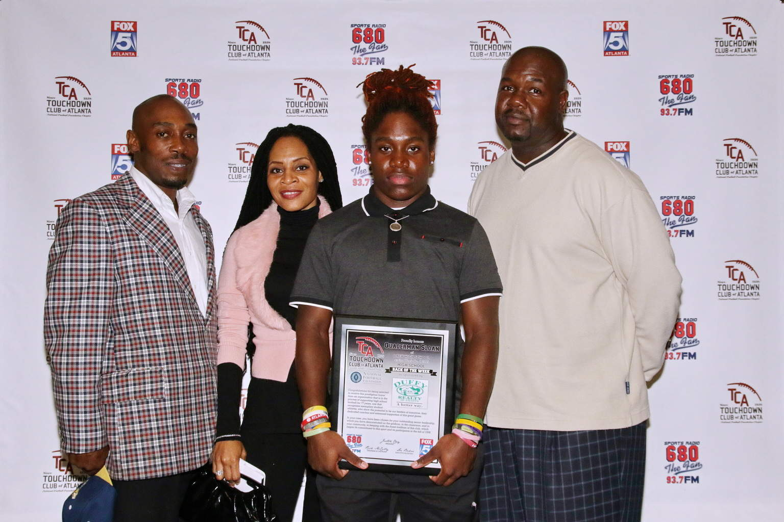 Quaderman Sloan & family with coach Dorwyn Lyles