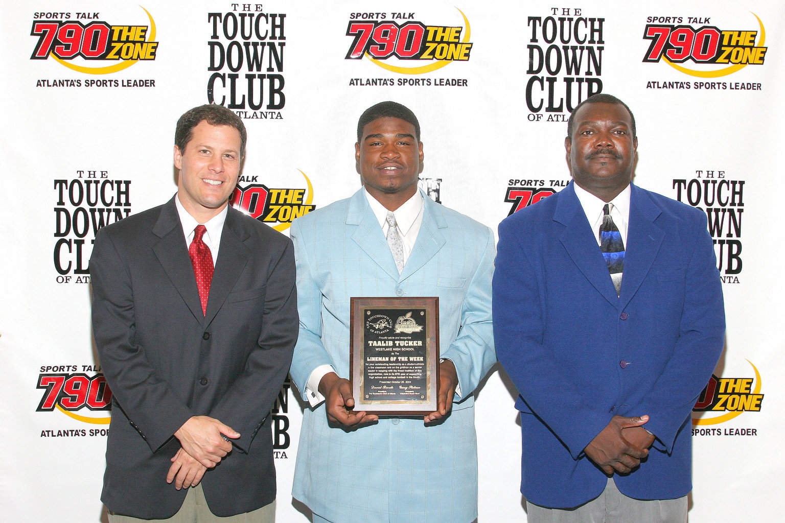 10-25-04 Taalib Tucker with Westlake coach Dallas Allen
